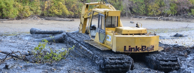 <p>Specialized equipment like this floating excavator was used throughout the project to access hard to reach areas </p>