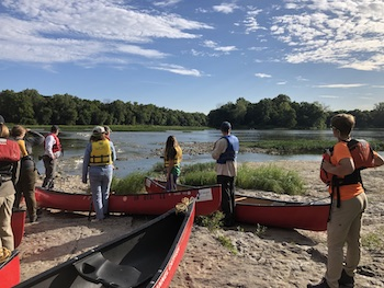 Cleanup participants and their canoes